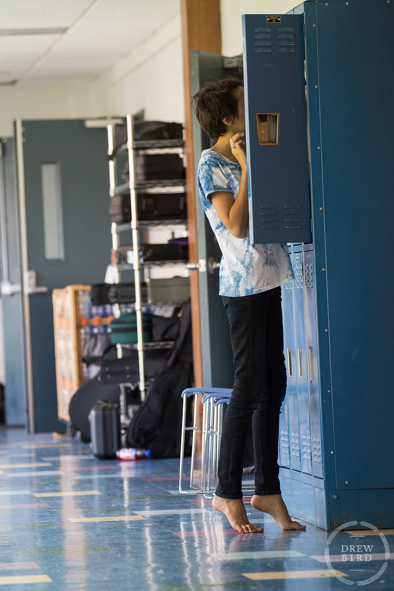 A student in bare feet on tip toes at their locker at Poughkeepsie Day School in Hudson Valley, New York. San Francisco education marketing photographer Drew Bird. San Jose school branding photographer.