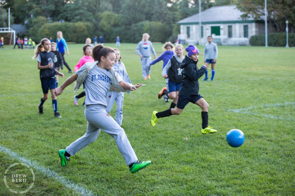 Girls soccer practice in the early morning before school at St. George's School of Montreal in Quebec, Canada. San Francisco independent school photographer and private school marketing photography and brand lifestyle photography by Drew Bird.