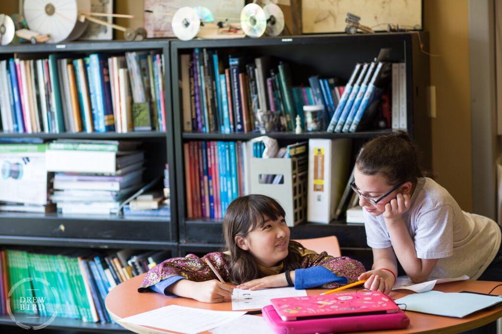 Two grade school students working together in the classroom at Poughkeepsie Day School in New York. San Francisco independent school photographer and private school education lifestyle photography by Drew Bird.